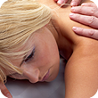 A woman's back being examined during her chiropractic first visit.