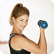 A woman curling a dumbbell weight.